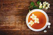 pic of jasmine  - tea with jasmine on a dark wood background - JPG