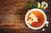picture of jasmine  - tea with jasmine on a dark wood background - JPG
