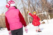 foto of snowball-fight  - Children in Winter Park playing snowballs - JPG