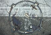 pic of cross-hatch  - Manhole with metal cover in asphalt with white zebra crossing marking line on it - JPG