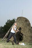 pic of scythe  - Senior farmer using scythe to mow the lawn traditionally - JPG