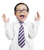 stock photo of boys  - Portrait of little boy in business suit with shocked expression isolated on white background - JPG