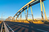 picture of arch foot  - Metal arch bridge for cars and trains - JPG