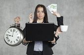 image of multitasking  - businesswoman is very multitasking - JPG