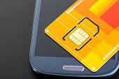 picture of micro-sim  - Yellow sim card on the phone - JPG