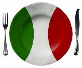 foto of italian flag  - Concept of Italian cuisine with empty plate colored with the colors of Italian flag and silver cutlery isolated on white background - JPG