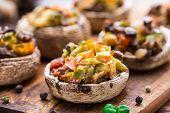 stock photo of portobello mushroom  - Portobello mushrooms stuffed with tomato, paprika, and mozzarella cheese. ** Note: Shallow depth of field - JPG