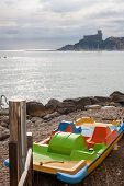 stock photo of pedal  - Pedal boat in the beach in Lerici Italy - JPG
