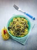 stock photo of turnips  - tagliolini with turnip top and hot chili pepper - JPG