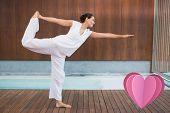 foto of shiva  - Content brunette in white in the shiva posture against heart - JPG