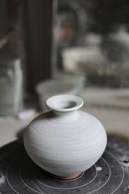 image of raku  - Several raku art pots inside of a pottery shop - JPG