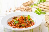 picture of chickpea  - Spinach chickpea curry fresh and healthy with herbs and lebanese bread - JPG