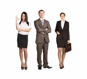 stock photo of coworkers  - Team leader stands with coworkers in background and in looking at camera on isolated white background - JPG