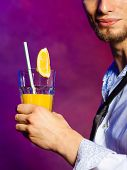 stock photo of bartender  - Young stylish man bartender preparing serving alcohol cocktail drink - JPG