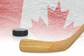 foto of hockey arena  - Stick puck and hockey field with a Canadian flag - JPG