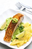 image of nachos  - grilled salmon fillet with avocado sauce and nachos - JPG