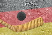 pic of hockey arena  - Hockey puck hockey stick and the image of the German flag on the ice - JPG