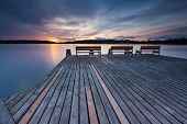 foto of long distance  - Beautiful long exposure landscape of lake in Mazury lake district  - JPG