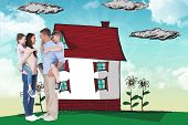 foto of piggyback ride  - Side view of parents giving piggyback ride to children against blue sky - JPG