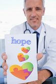 foto of prescription pad  - The word hope and portrait of a male doctor showing a blank prescription sheet against autism awareness heart - JPG