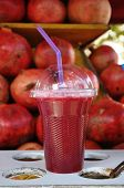 picture of pomegranate  - fresh pomegranate juice and pomegranate fruits on the background - JPG