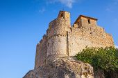 stock photo of yellow castle  - Medieval stone castle on the rock in Spain - JPG