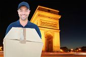 image of charles de gaulle  - Happy delivery man holding cardboard box against arc de triumphe in france - JPG