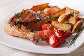 pic of roast chicken  - Grilled chicken leg roasted potatoes and vegetables on a plate close - JPG