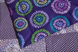 picture of stitches  - Purple patterned quilt close up - JPG