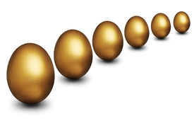 picture of nest-egg  - Golden nest eggs against a white background representing financial security - JPG