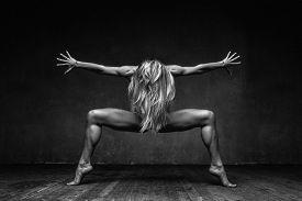 stock photo of  dancer  - young beautiful dancer posing in studio - JPG