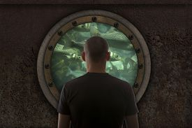 pic of ironclad  - Captain looks out the window of the submarine - JPG