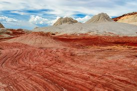 stock photo of plateau  - Plateau from white and red sandstone, White Pocket at sunrise. The area of Vermilion Cliffs on the Paria Plateau in Northern Arizona, USA ** Note: Soft Focus at 100%, best at smaller sizes - JPG