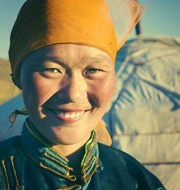 foto of mongolian  - Mongolian Woman Traditional Dress Tranquil Solitude Concept - JPG