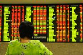 picture of stock market data  - asian woman watching stock market index - JPG