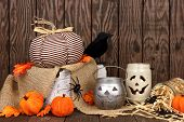 Rustic Shabby Chic Halloween Decor Against An Aged Wood Background poster