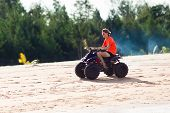 Teenager Riding Quad Bike On Beach poster