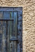 Old, Weathered Door and Mud Wall