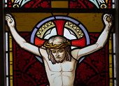 image of inri  - detail of victorian stained glass church window in Fringford depicting Jesus nailed to the cross - JPG