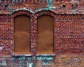 pic of ybor city  - boarded up windows in an old brick building in ybor city - JPG