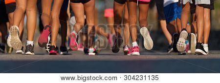 poster of Running Children, Young Athletes Run In A Kids Run Race,running On City Road Detail On Legs,running