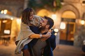 Smiling man and woman in love, enjoying in evening walk together  poster