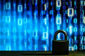Closed Padlock In Front Of Blue Floating Binary Code Background. Cyber And Computer Security Concept poster