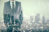 Businessman Standing On Abstract City Background With Forex Chart And Blurry Bokeh Circles. Stats An poster