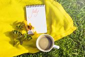 Notepad Is Lying On Grass. Summer Bright Sunny Cozy Still Life. The Inscription On The Notebook Is M poster