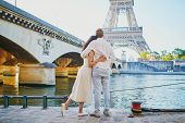 Happy Romantic Couple In Paris, Near The Eiffel Tower. Tourists Spending Their Vacation In France poster