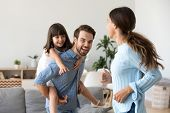 Playful Parents Have Fun Playing With Preschooler Daughter poster