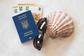 Travel And Holidays In Europe Or Abroad. Ukraine Passport For Traveling In Europe Against The Backgr poster