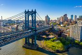New York, New York, Usa Skyline With Brooklyn And Washington Bridges Near The Manhattan Island. poster