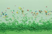 Green Sprinkles On Two Tone Green Background With Multi Coloured Sprinkles Scattered - Green Sprinkl poster